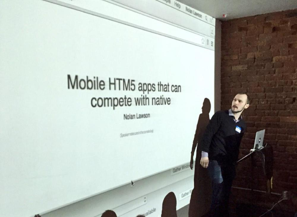 Picture of the author in front of a projection saying Mobile HTML5 apps that can compete with native